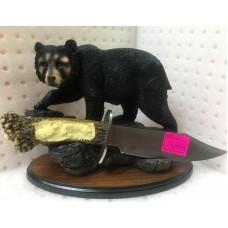 Настольный зверь с ножом